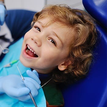 Smiling toddler in dental chair