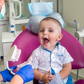 Young toddler getting a dental exam