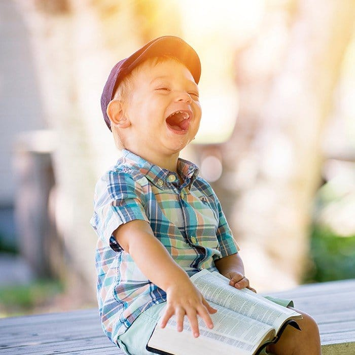 Laughing little boy on a dock