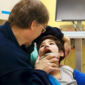 Boy receiving dental exam